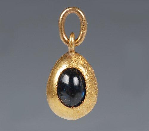 A Russian gem-set gold pendant egg, circa 1900. Lot 107. Estimate: $1,500-2,500
