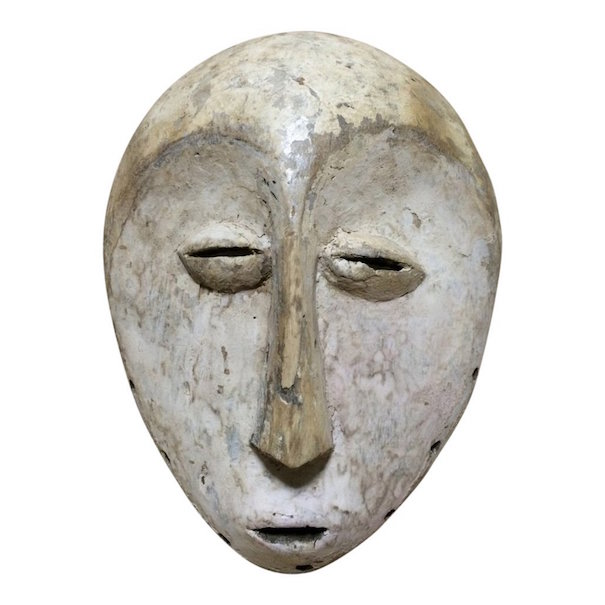 Lega carved wood mask, 11 1/2 x 8 4/4 inches. Estimate: $300-$400