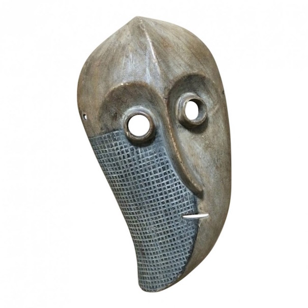 Pende mask, carved wood, Democratic Republic of the Congo, 15 x 8 1/2 inches. Estimate: $200-$300