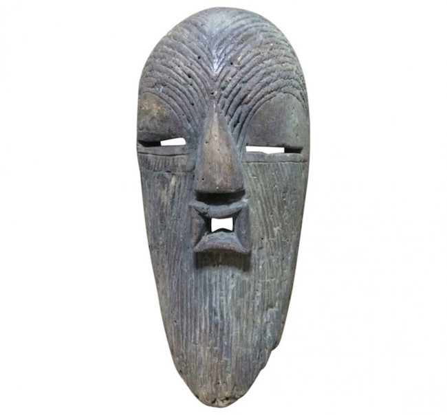 Songye carved wood mask, 8 1/2 x 8 3/4 inches. Estimate: $400-$500