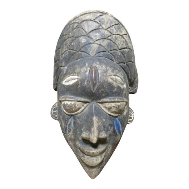 Yoruba carved wood mask, 14 x 8 1/2 inches. Estimate: $200-$300