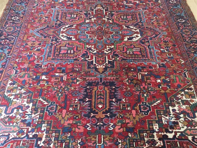 Semi-antique Persian Heriz, 10 feet 11 inches x 7 feet 9 inches. Estimate: $700-$1,000
