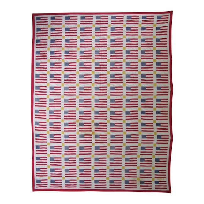 Twentieth-century quilt with graphic rows of American flags. Estimate: $200-$300
