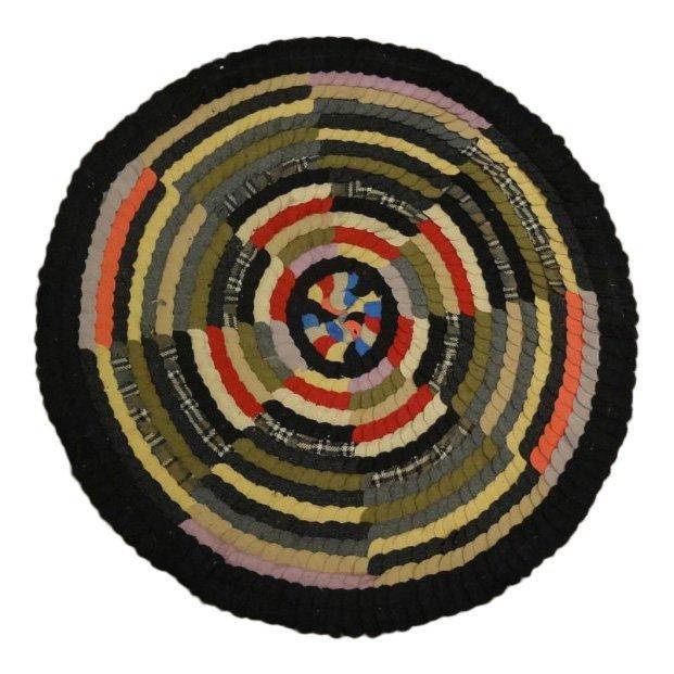 Handmade kaleidoscope rug. Estimate: $150-$250