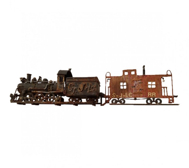 Handmade locomotive and caboose weather vane, circa 1920, 14 inches high by 24 inches long. Estimate: $1,000-$1,500