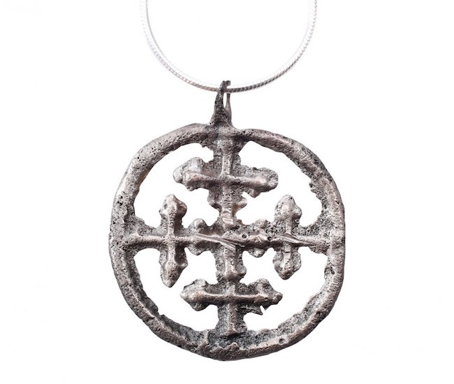 Crusader's cross pendant, Byzantine pilgrim's reliquary cross, silvered bronze, A.D. 1000-1200, 1 inch. Estimate: $200-$300