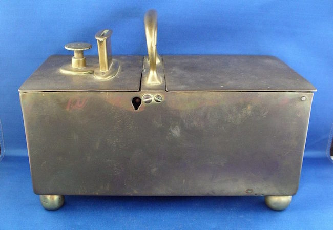 Pub tobacco box, 19th century, brass, 9 1/2 x 7 x 4 3/4 inches. Estimate: $600-$700