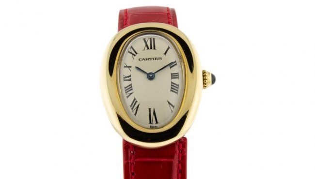 Cartier 18K gold curved case watch, Model 0211, circa 2006. Estimate: $3,500-$4,000