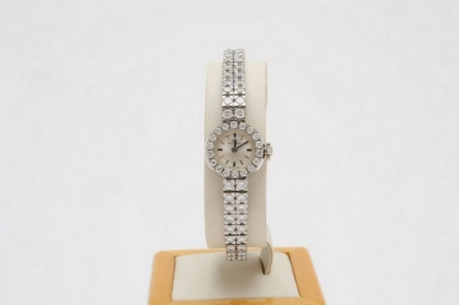 Bucherer diamond tennis bracelet watch, 18K gold case. Estimate: $4,000-$5,000