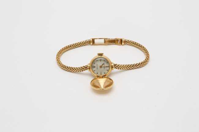 Rolex solid 18K gold cover watch, 1960s, 15mm diameter. Estimate: $3,000-$3,500