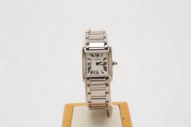 Solid white gold Cartier Tank watch, quartz movement, circa 2000. Estimate: $6,500-$8,000