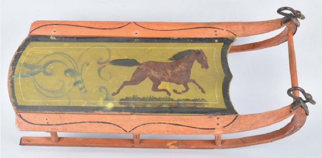Early painted-wood child's sled with stenciled horse motif and cast-iron rails terminating in figural swan decorations. Image courtesy of LiveAuctioneers and Milestone Auctions