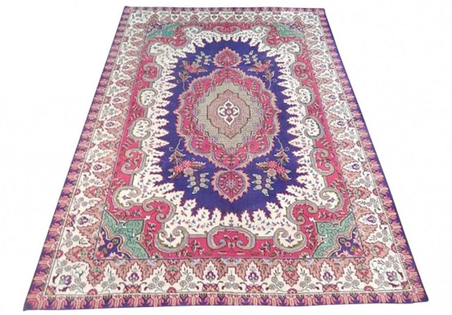 Tabriz rug, 1980, wool, 6 feet 8 inches x 9 feet 7 inches. Sold for $460. Image courtesy of LiveAuctioneers/Jasper52