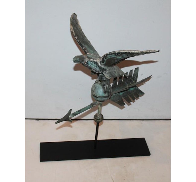 Diminutive eagle full-body weather vane on stand, 1880-1890, 22 inches high x 19 inches wide x 15 inches deep. Estimate: $1,675-$3,850