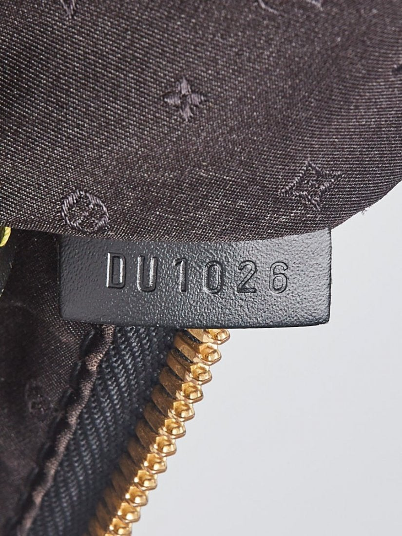 A clear example of an internal leather tag in the same color as the leather trim features two letters and four numbers for this Black Suhali Leather Lockit MM Bag that translates as being handmade in Paris in December of 2006 (letters DU is code for France; first and third numbers indicate month; second and fourth number indicate year). Image courtesy Japan Treasure Auction and LiveAuctioneers